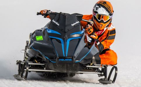 Stephen Manke racing a snowmobile